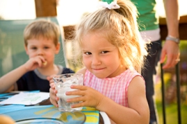 little girl holding glass of water FOR WEBSITE